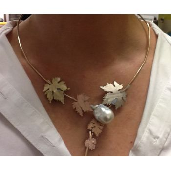 Bev models the neckpiece, confirming the layout of the vine leaves